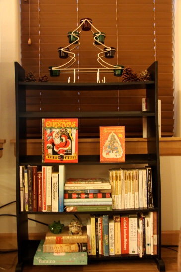 Our living room book shelf with Man-Beast's old Christmas books from when he was a kid.