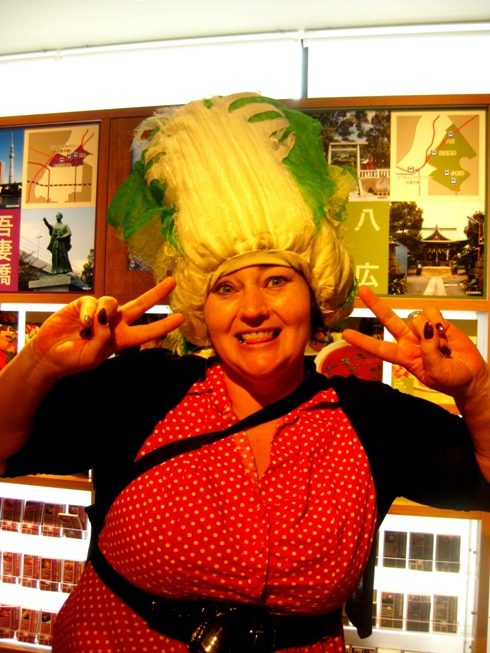 Author Kathryn O'Halloran wearing a bok choy hat! Both healthy and exotic!
